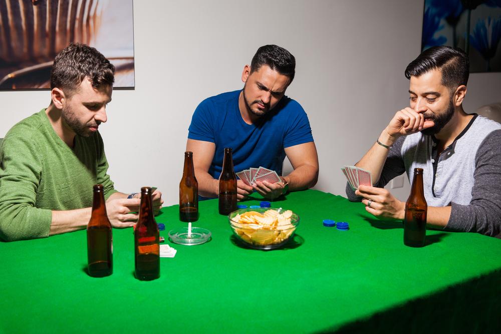 Three friends during poker night