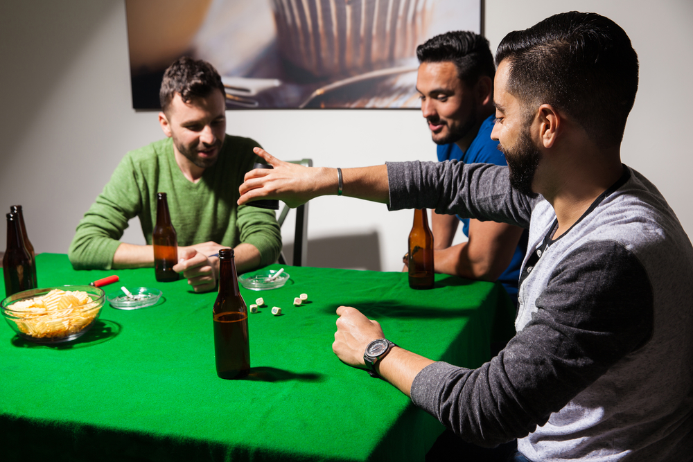 Men playing dice and drinking beer